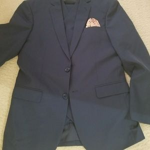Three piece suit with pocket square